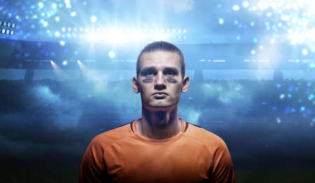 Soccer player in the 3d imaginary stadium.The imaginary soccer stadium is modeled and rendered.