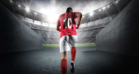 3D架空のスタジアムに入るサッカー選手。想像上のサッカースタジアムはモデル化され、レンダリングされます。 写真素材 - 105533320