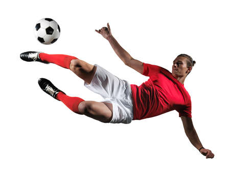 Soccer player in action on white background.