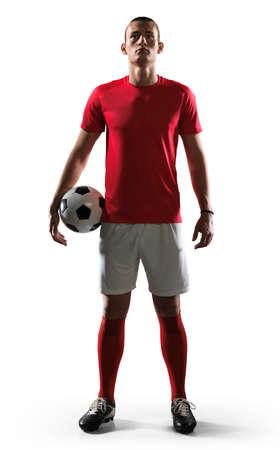 Soccer player standing on white background.Photo of soccer player on isolated background. Standard-Bild
