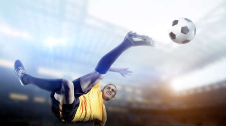 Soccer player in action on stadium background. The imaginary stadium is modelled and rendered. Standard-Bild