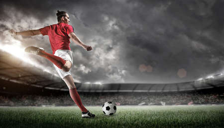 Soccer player in action on stadium background. The imaginary stadium is modelled and rendered. Zdjęcie Seryjne