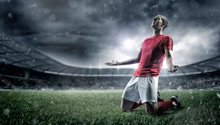 Football player in the stadium, joy of goal. The imaginary stadium is modelled and rendered.