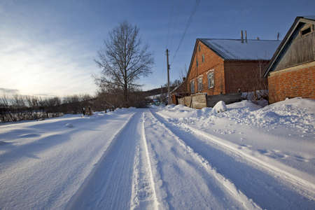 Village street with a road on a clear winter day after a fresh snow Stock Photo - 8646755