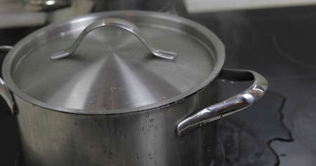 Boiling Water In The Pan that is covered with a lid in the kitchen.