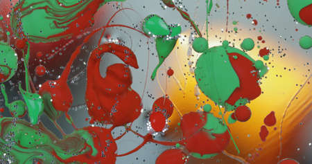 Abstract psychedelic background. Ink in a multicolored liquid. Colorful paint drops mixing in water. River of liquid. Colorful paint Reklamní fotografie