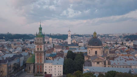 Aerial roofs and streets Old City Lviv, Ukraine. Central part of old european city in morning. Panorama of the ancient town. City Council, Town Hall, old Dominican Church. Drone shot
