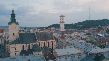 Aerial roofs and streets Old City Lviv, Ukraine. Central part of old european city in morning. Panorama of the ancient town. City Council, Town Hall, Ratush, old Latin Cathedral Church. Drone shot