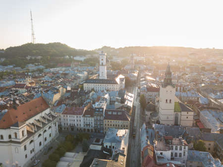 Aerial roofs and streets Old City Lviv, Ukraine. Central part of old european city in morning time. Panorama of the ancient town. City Council, Town Hall, Ratush. Drone shot