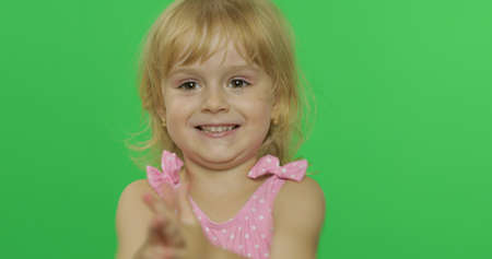 Pretty girl in pink swimsuit smiles. Portrait close up. Cute little blonde child, 3-4 years old. Summer vacation concept. Green screen. Chroma Key