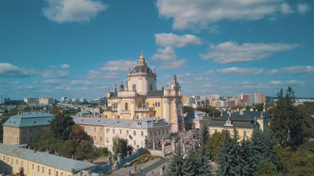 Aerial view of St. Jura St. Georges Cathedral church against cloudscape in old town Lviv, Ukraine. Shot by drone Greek Catholic Cathedral of city. Main shrine of the Ukrainian Greek Catholic