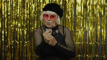 Dont do it. Senior old woman asking to stop and showing restrict gestures with hands, displeased with something shameful awful, ugly, danger. Elderly stylish lady grandma in studio