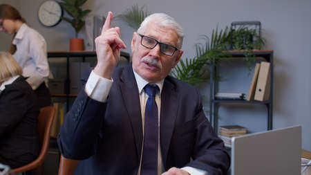 Senior mature old business man pointing to camera, choosing lucky one winner, meaning we need you, showing direction, noticing, pointing finger up. Coworking, cooperation. Freelance business