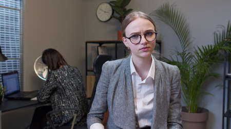 Displeased upset young female business company manager irritated sad angry mad after analyzing financial papers in office. Businesswoman accountant reading documents, analyzing financial papers data Standard-Bild