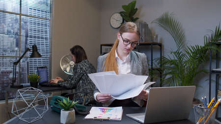 Displeased upset businesswoman accountant throwing documents after analyzing financial papers. Manager irritated sad angry mad after analyzing financial papers in office. First day at work. Bad day
