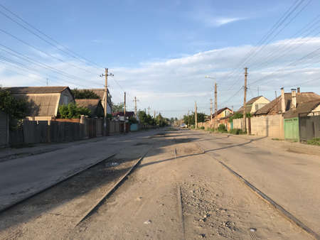 empty old dusty road in a small town fly in the evening.