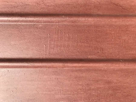 background texture of the metal fence of the garage red color.