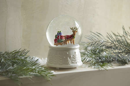 Big Snowglobe with Christmas tree Festive decoration, Reindeer in Snowglobe Stock Photo