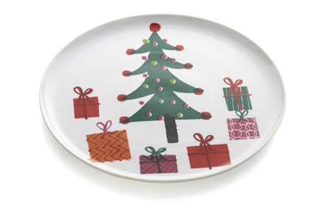 Christmas decorations Round Platter, house festive decoration, isolated. Christmas table place setting with red plate, cutlery in santa. Banco de Imagens