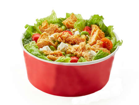 Fast Food Caesar salad bowl with brad, lettuce and cherry tomatoes, isolated. Close up of take away bowl paper carton kraft with fast food salad on white background.