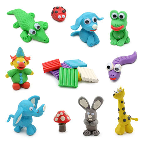 clay craft: animals made from childs play clay isolated on white background