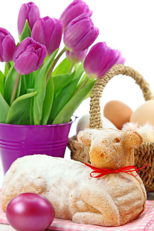 Easter lamb cake and purple tulips   photo