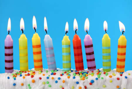 cake with icing: Nine birthday candles on blue background