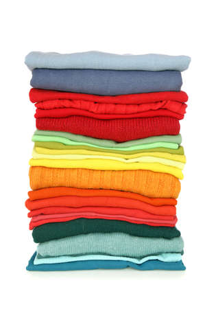 Stack of clothes isolated on white background  photo