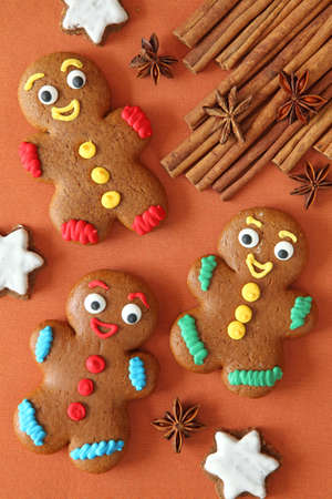 spicecake:  Gingerbread men on brown tablecloth