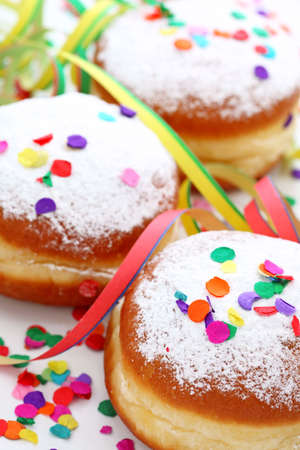 Krapfen or donuts with jam and icing sugar  photo