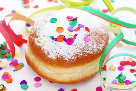 Krapfen or donut with jam and icing sugar  photo