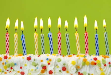 birthday candles:  Colorful birthday candles on green background