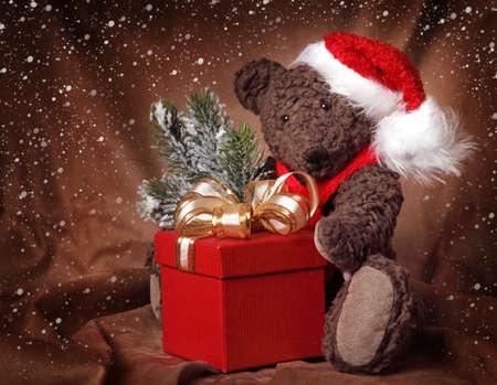 classic santa: Christmas teddy bear on brown background