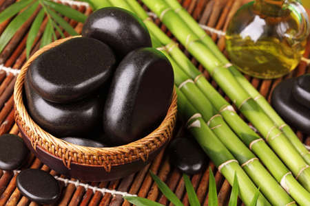 hot rock therapy: Spa still life with hot stones and essential oil