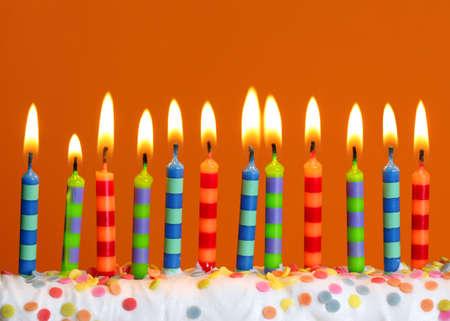 Birthday candles on orange background photo