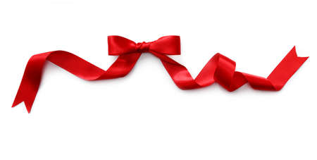 red ribbon bow: Red satin ribbon with bow isolated on white background Stock Photo