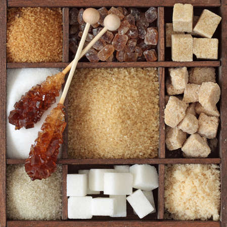 sugar cubes: Various kinds of sugar in wooden box Stock Photo
