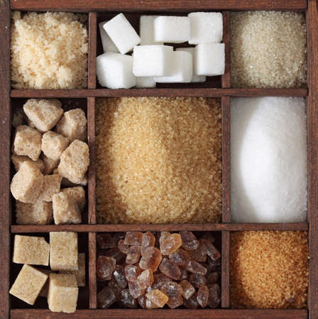 Various kinds of sugar in wooden box photo