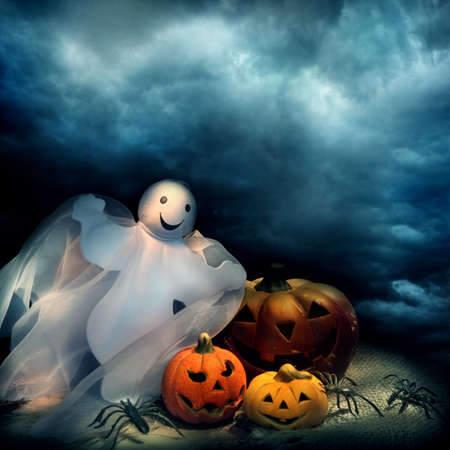happy halloween: Halloween pumpkins and ghost at night  Stock Photo