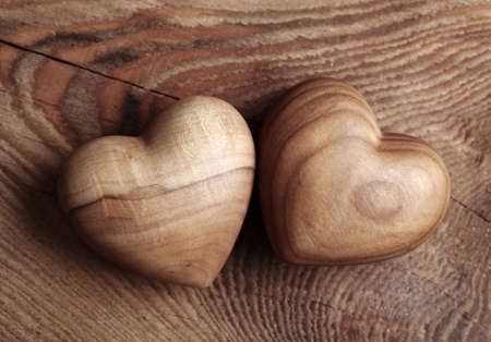 valentin: Two wooden hearts on brown background Stock Photo
