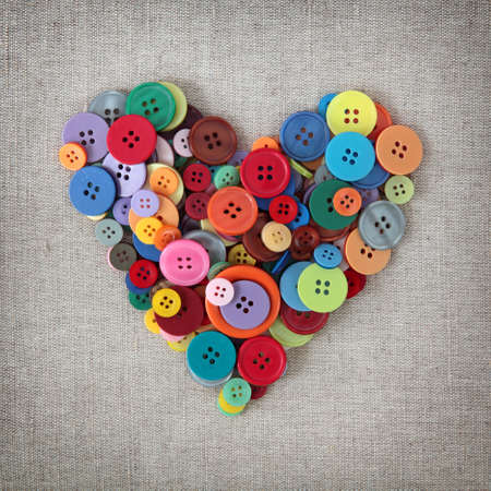 valentin: Colorful buttons heart on sacking Stock Photo