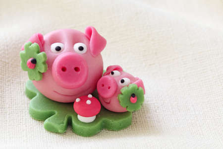 Marzipan pig with cloverleaf and mushroom Stock Photo - 10313972