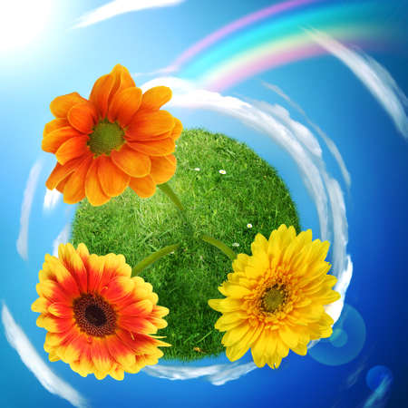 Green small planet with flowers and rainbow photo