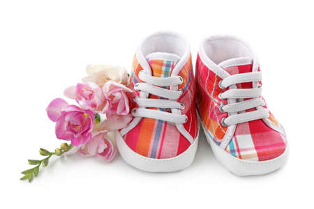 baby feet: Pink baby girl shoes isolated on white background Stock Photo