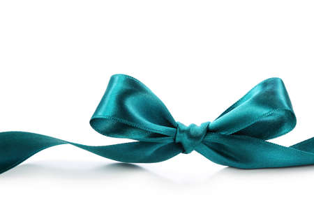 Green bow isolated on white background photo