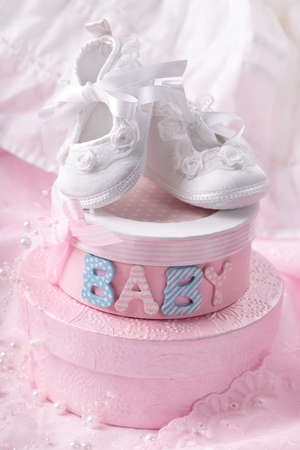 christening: Little baby booties and gift boxes Stock Photo