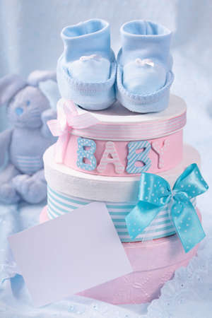 baby clothes: Little baby booties and gift boxes with blank note Stock Photo
