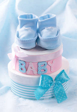 baptism: Little baby booties and gift boxes Stock Photo
