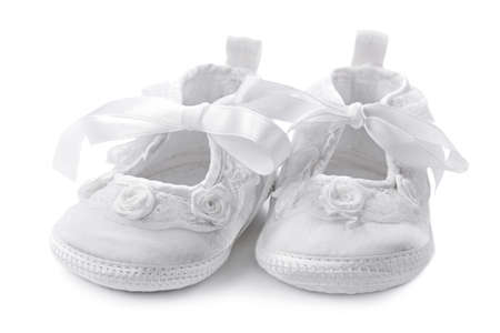 baptism background: Baby girl shoes isolated on white background