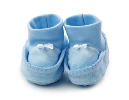 baptism background: Blue baby booties on white background Stock Photo
